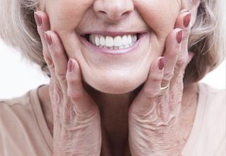 older woman smiling | dental crowns jonesboro ar