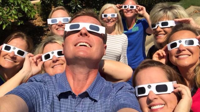 group staring at sun with glasses | Bartels Family Dentistry