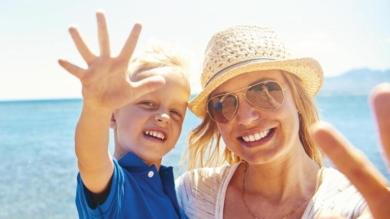 mother and son on beach | Jonesboro dentist